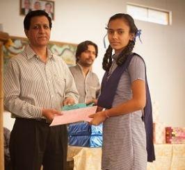 Radhika, receiving her honour